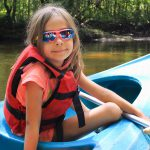 Girl kayaking in the Pine Barrens of New Jersey