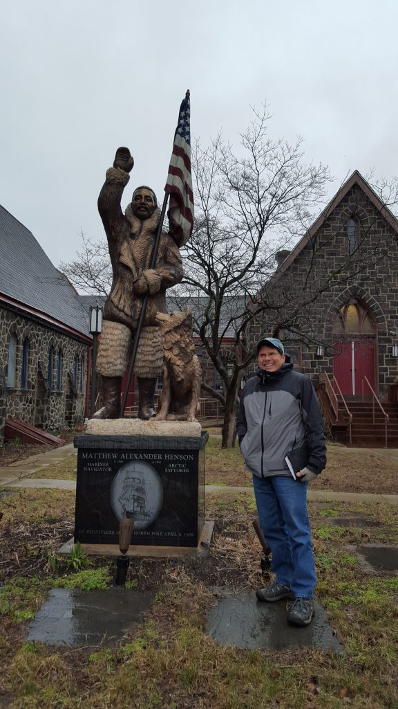"It turns out Perry wasn't alone when he ""discovered"" the North Pole. His co-discoverer was Matthew Henson, an African American from Maryland. Pinelands Adventures Director of Education John Volpa is pictured here with a statue of Henson outside the Camden Shipyard & Maritime Museum. We visited on a rainy day in February to meet with Jim Cummings of Urban Trekkers. They build boats with students in Camden!"
