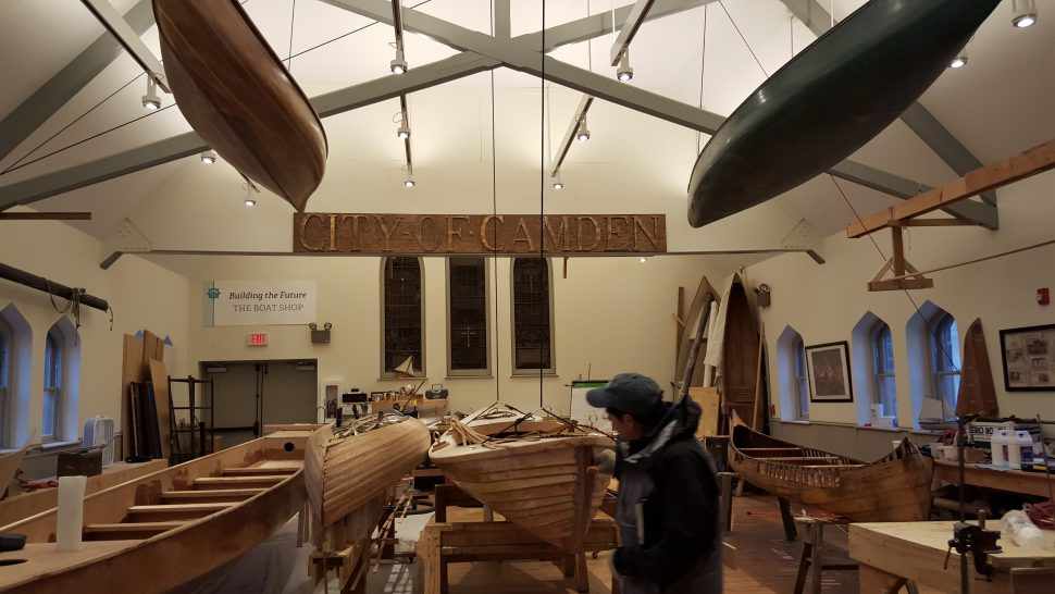 Pinelands Adventures Director of Education John Volpa inspects a skiff at the Camden Shipyard & Maritime Museum